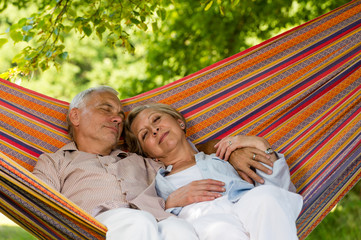 Senior couple sleeping in hammock