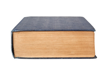 Closeup of the bottom edge of a book isolated on white