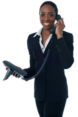 Cheerful lady attending clients call
