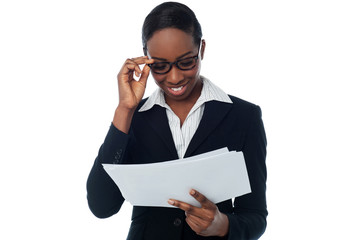 Businesswoman analyzing report
