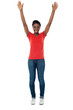 Excited woman raising her arms up