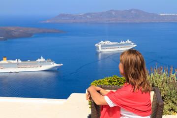 young woman enjoying view of Santorini, Greece