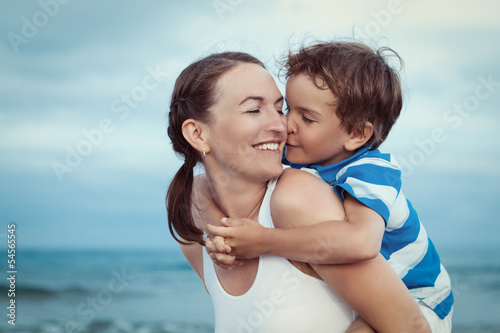 Portrait of happy mother and son at sea