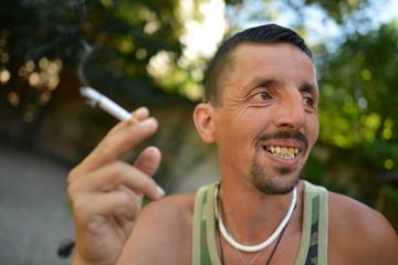 latino man smoke cigarettes