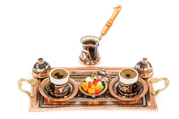 Turkish coffee served in a traditional Turkish metal dish cup