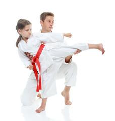 Dad helps daughter learn beat kick leg