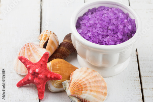 Sea salt in bowl  and shells on wooden background