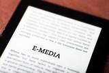 E-media on ebook, tablet concept