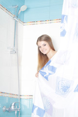 young beautiful woman taking shower at home