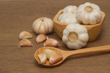 Garlic in wooden spoon