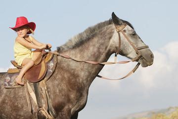 girl riding a horse on farm outdoor portrait
