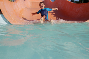 happy child boy having fun in aqua park