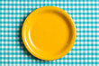 Leinwanddruck Bild - empty plate on checkered tablecloth
