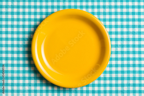 empty plate on checkered tablecloth
