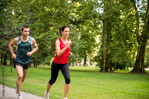 Training together - young couple jogging