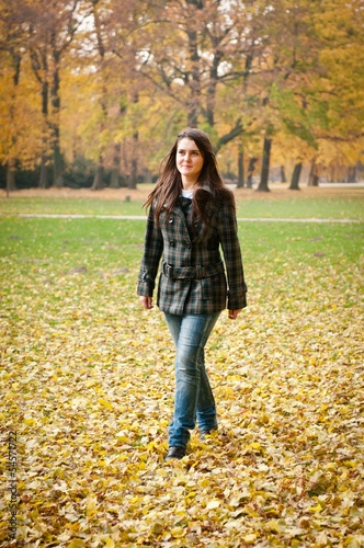 Autumn joy - young woman outdoor