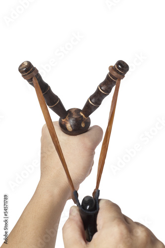 Hand holding a slingshot ready to launch