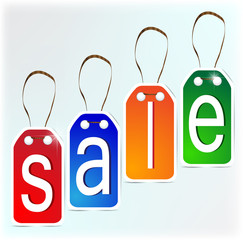Multi-colored signs made of paper. SALE