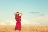 Redhead girl at wheat field