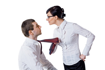 woman pulls the man for a tie