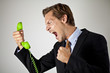 Businessman screaming at phone