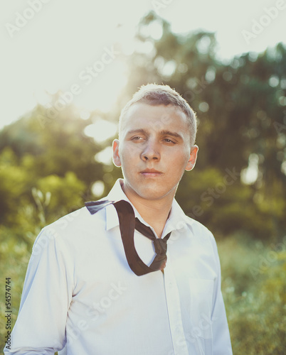 Cute guy in a tie and white shirt