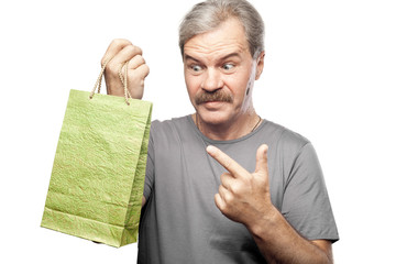 surprised mature man holding shopping bag isolated on white back