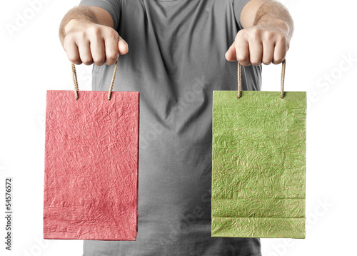 man holding two shopping bags isolated on white background. choi