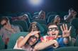 Watching three-dimensional movie. Terrified people in three-dime
