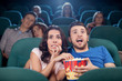Couple watching horror movie. Terrified people in watching movie