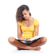 Teenager girl sitting and studying