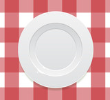 realistic empty plate on tablecloth