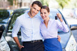 Young couple with keys to new car