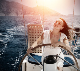 Woman behind the wheel yacht