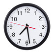 Round wall clock shows half past