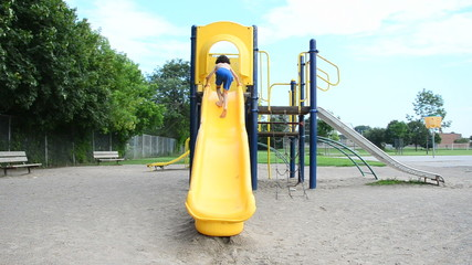 Shirtless Child Playing in Playground