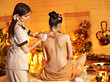 Woman getting thai herbal massage ball.