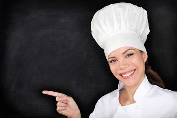 Chef pointing showing blank menu blackboard