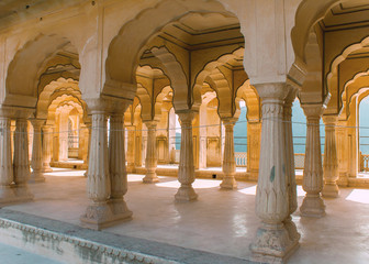 Gallery of rimmed pillars in light sunshine at Jaipur's Amber Fo