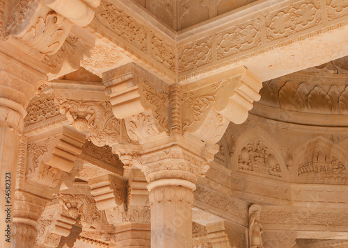 Extensive artful carving in amber sandstone inside cremation pav