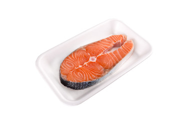 Piece of a salmon in a plate isolated on a white background