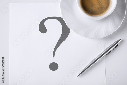 note with question mark and coffee