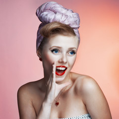Beautiful young sexy pin-up girl with surprised expression