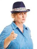 Mature Woman Points at Camera