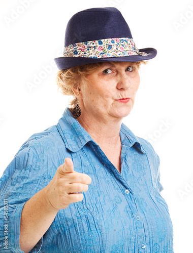 Mature Woman Points at Camera