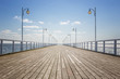 Leinwanddruck Bild - Old empty wooden pier over the sea shore with copy space