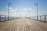 Old empty wooden pier over the sea shore with copy space - 54586710