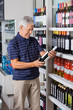 Man Buying Alcohol At Supermarket