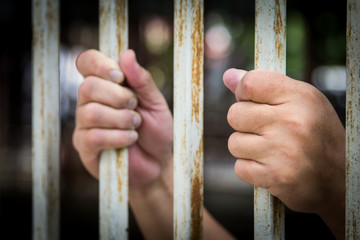 hand in jail