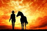 Cow girl and horse at sunset